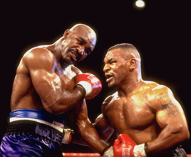 mike-tyson-and-evander-holyfield. The Real Deal Holyfield,