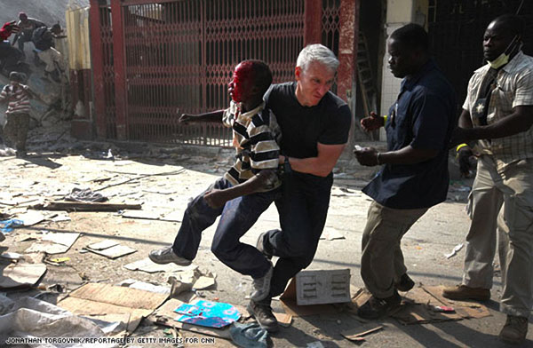 anderson-cooper-saves-haitian-boy