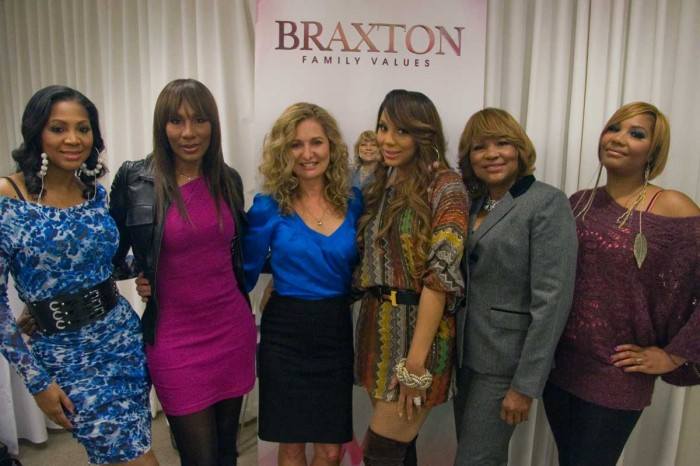 Braxtons with WE tv President Kim Martin