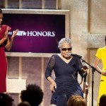 U.S. first lady Michelle Obama applauds BET honoree, author Maya Angelou, as Willow Smith holds her award at the BET Awards in Washington