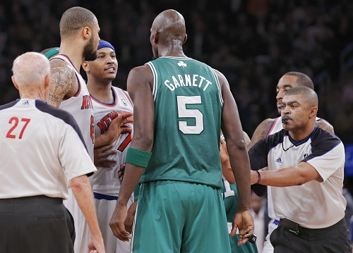 Referee Brothers moves to break up New York Knicks' Anthony and Boston Celtics' Garnett as they argue during their NBA basketball game in New York