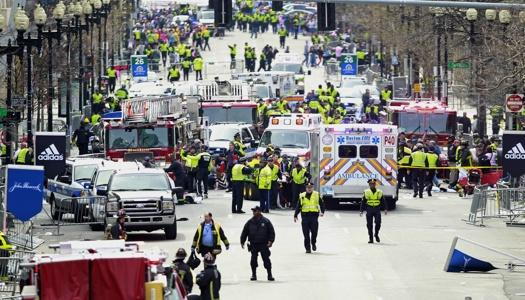 Police clear the area at the finish line of the 2013 Boston Marathon.
