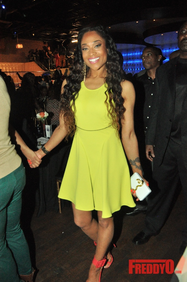 Mimi Faust went high fashion in a $695 neon yellow racerback Just Cavalli dress and $695 Gucci Victoire Sandals.