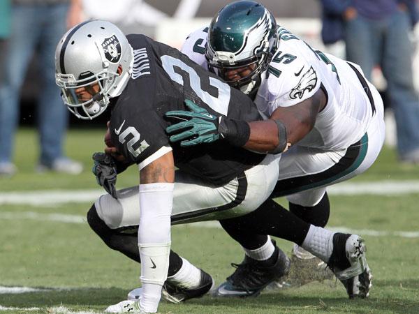 Vinny Curry sacks Raiders quarterback Terrell Pryor. (Yong Kim/Staff Photographer)
