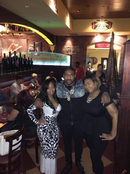 from l to r: elite famed entertainment's owner stacy J, dj holiday, and streetz 94.5 winner ashley little